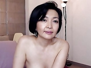 Older Asian milf teases, big tits